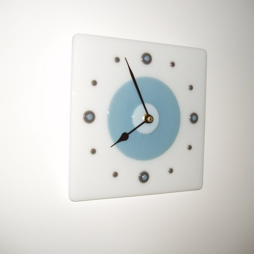 white & pale blue wall clock